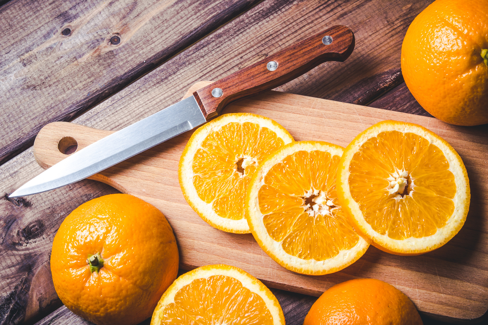 Orange slices on wooden table.